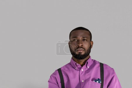 portrait of handsome african american man in stylish clothing isolated on grey