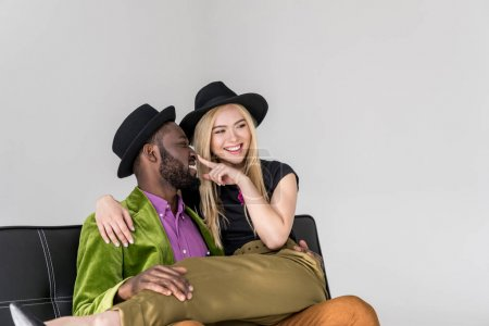 Photo for Happy stylish young multiethnic couple having fun together isolated on grey - Royalty Free Image
