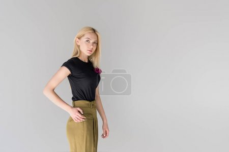 Photo for Beautiful blonde girl looking at camera and posing isolated on grey - Royalty Free Image