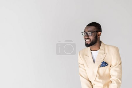 Photo for Portrait of handsome young african american man in eyeglasses smiling and looking away isolated on grey - Royalty Free Image