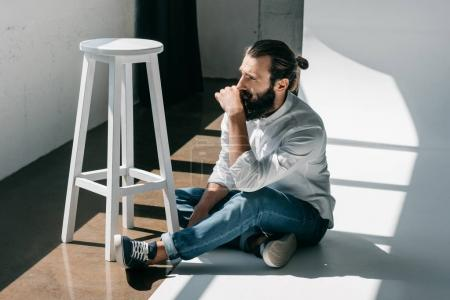 Photo for Handsome man in casual wear sitting on floor - Royalty Free Image