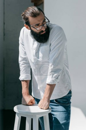Photo for Handsome young bearded man with eyeglasses looking away - Royalty Free Image