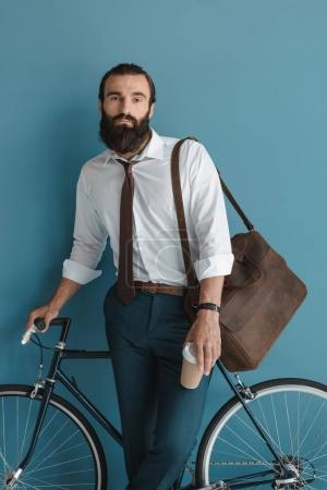 businessman with vintage bicycle