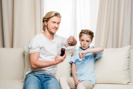daughter and father holding syrup