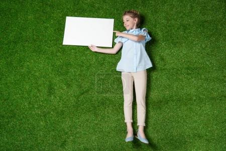 girl pointing at empty banner