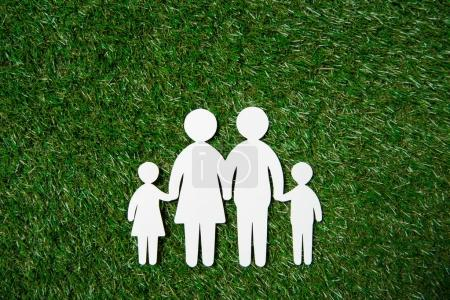 paper cut of family on grass