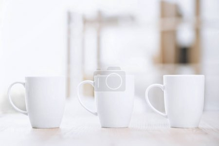 Photo for Selective focus of white cups of coffee standing on table - Royalty Free Image