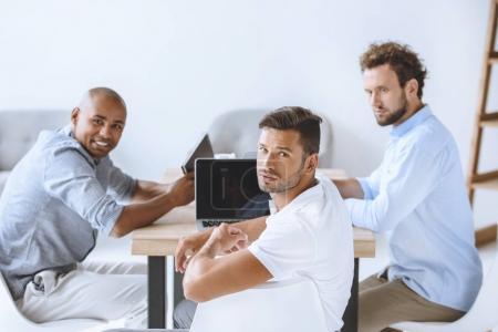 multicultural businessmen in office