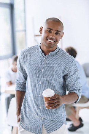 african american businessman with coffee to go