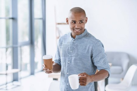 african american businessman with coffee cups