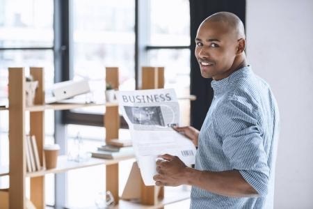 african american businessman with newspaper