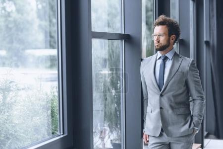 Pensive businessman in suit