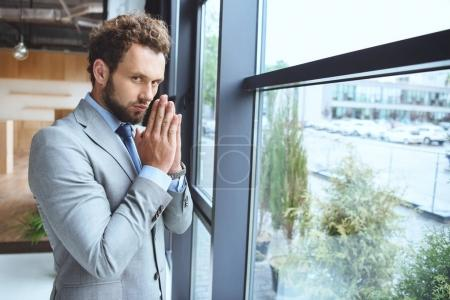 Caucasian businessman praying