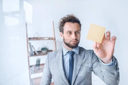 businessman point at sticky note