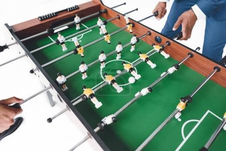 Photo for Cropped shot of businessmen playing table football isolated on white - Royalty Free Image
