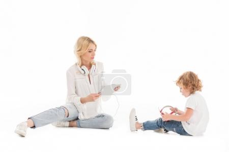 Mother and son with digital devices