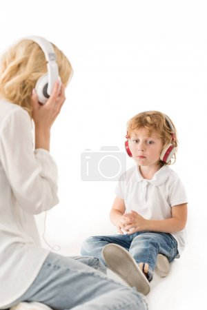 mother and son in headphones