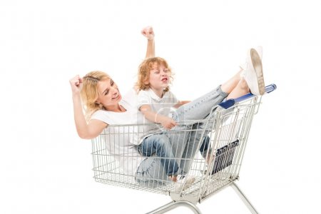 Family sitting in shopping cart