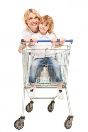 Mother and son with shopping cart
