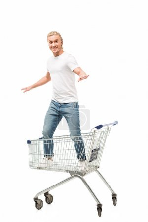 man standing in shopping cart