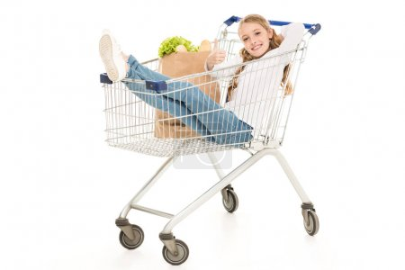 kid sitting in shopping cart