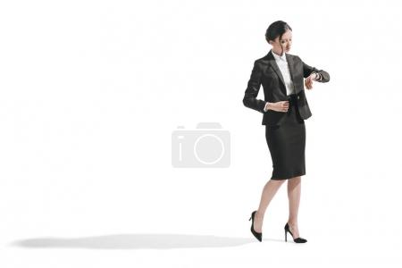 busy businesswoman looking at watch