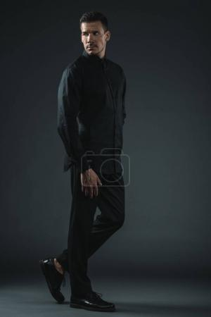 fashionable man in black outfit