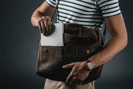 Stylish man with leather bag