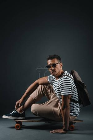 Stylish man with skateboard