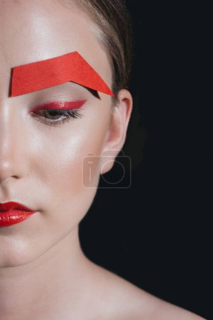 beautiful woman with paper eyebrow