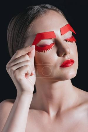 woman with paper eyelashes
