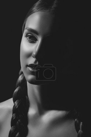 Photo for Black and white portrait of sensual young woman with braids looking away - Royalty Free Image