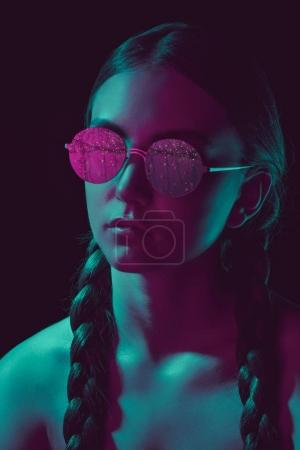 Photo for Portrait of thoughtful young woman in stylish round sunglasses - Royalty Free Image