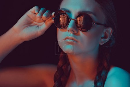 Photo for Portrait of caucasian young woman with braids in fashionable sunglasses - Royalty Free Image