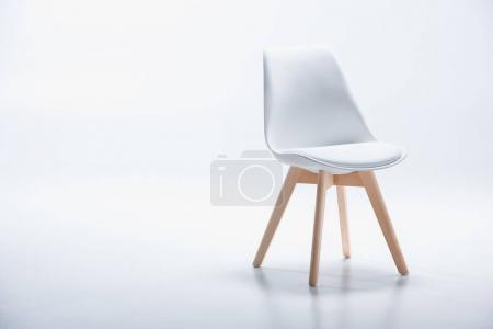 Photo for Studio shot of stylish chair with white top and light wooden legs standing on white - Royalty Free Image