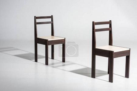 dark wooden chairs in row