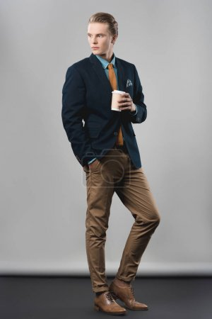 Photo for Handsome young businessman with coffee to go - Royalty Free Image