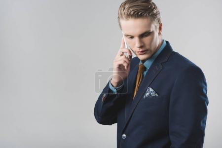 young businessman talking by phone