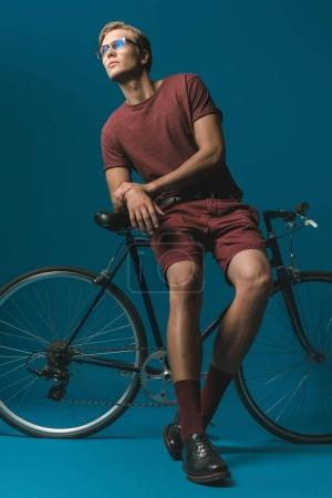 young man with vintage bicycle