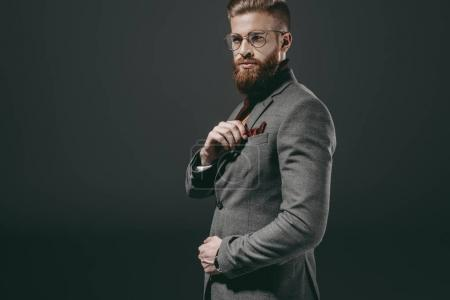 Photo for Portrait of handsome bearded man in eyeglasses isolated on black - Royalty Free Image