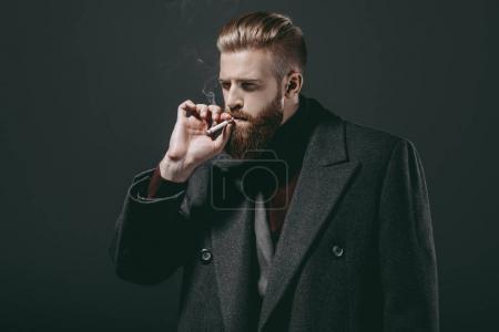 Stylish man smoking cigarette