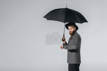 stylish man in hat with umbrella