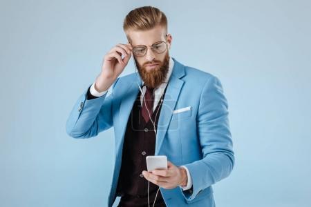 stylish man in earphones with smartphone