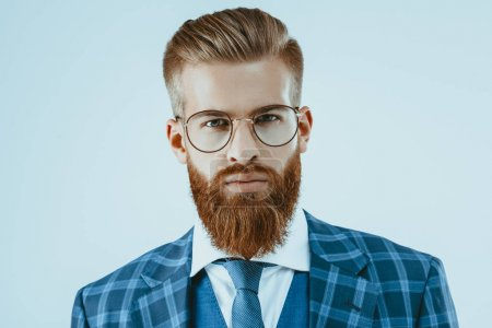 Photo for Head and shoulders shot of man in eyeglasses with stylish hairstyle isolated on blue - Royalty Free Image