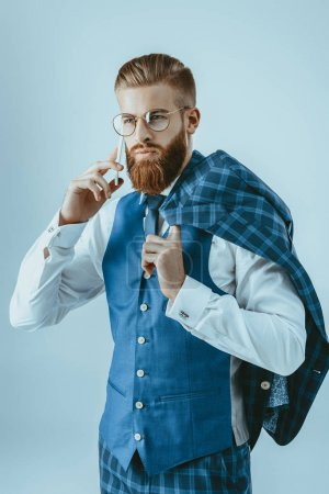 fashionable man talking on smartphone