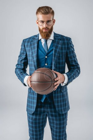 handsome man in suit with basketball ball