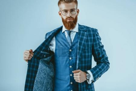 Photo for Portrait of fashionable bearded man in blue jacket isolated on blue - Royalty Free Image