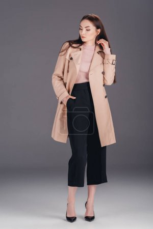 fashionable young woman in coat