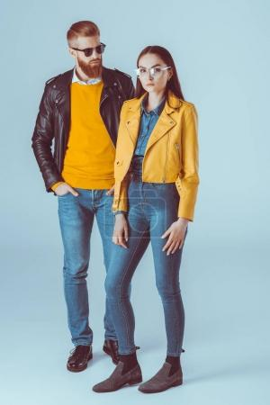 fashionable couple in leather jackets
