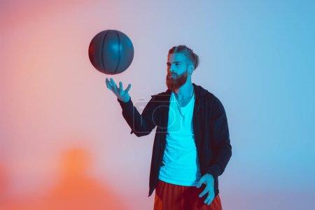 young man with basketball ball